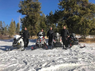 A group of snowmobile riders